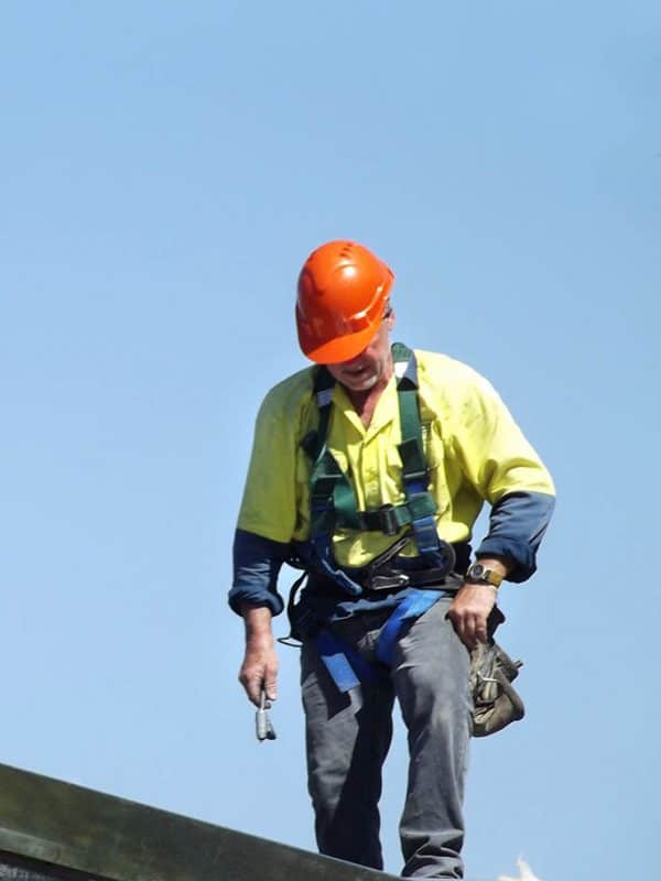 Re-Roofing-Services-man-on-roof-600x800